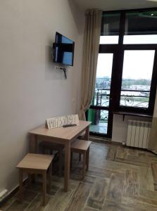 Телевизор и/или развлекательный центр в Appartment on Belorysskaya
