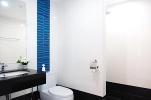 A bathroom at The Malika Hotel - SHA Plus