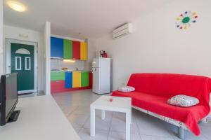 A seating area at Beachfront Apartments Villa Šiša