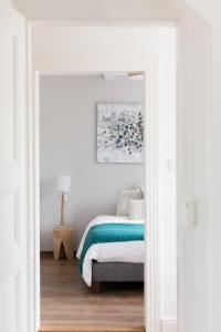 A bed or beds in a room at Reflets Sur La Lauch appartements