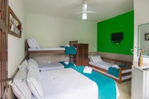 A bed or beds in a room at Pousada Recanto verde