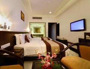 Cama o camas de una habitación en Hotel Taj Resorts