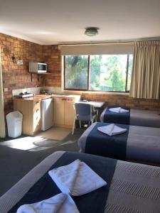A seating area at Ocean View Motor Inn Merimbula