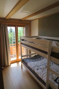 A bunk bed or bunk beds in a room at Mayen de l'Art d Vivre