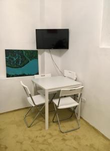Televízia a/alebo spoločenská miestnosť v ubytovaní City Center AP 2
