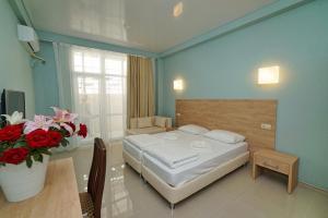 Кровать или кровати в номере Villa Park Victoria