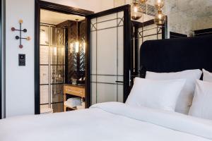 Łóżko lub łóżka w pokoju w obiekcie Amerikalinjen