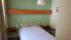 Un ou plusieurs lits dans un hébergement de l'établissement Auberge Le Moulin Du Plain