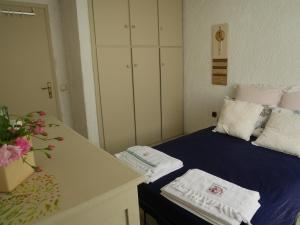 A bed or beds in a room at Villa Depy