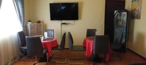 Télévision ou salle de divertissement dans l'établissement Residence Hoteliere Olympus