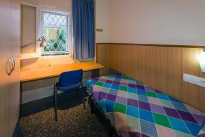 A bed or beds in a room at Residencia Sants