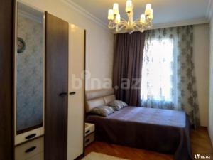 Cama ou camas em um quarto em Apartment Nizami 60, Baku