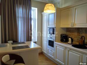 A cozinha ou cozinha compacta de Apartment Nizami 60, Baku