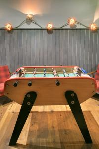 A pool table at Hotel Kaijoo by HappyCulture