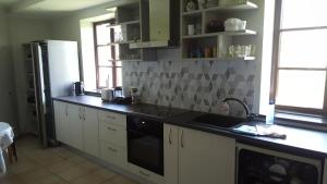 Kuchyňa alebo kuchynka v ubytovaní Guest House Pilskalni