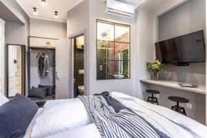 A bed or beds in a room at Deluxe Ploech