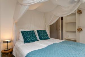 Cama ou camas em um quarto em Aan de Cauberg