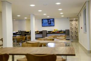 A restaurant or other place to eat at Grand Café Hotel