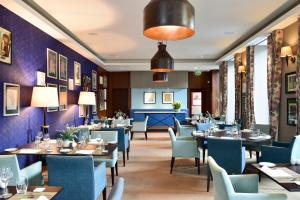 A restaurant or other place to eat at The Editory Artist Baixa Porto Hotel