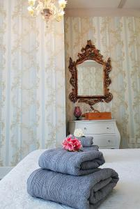 A bed or beds in a room at Miglioranzi Antonio Rooms