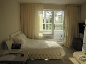 Кровать или кровати в номере Max House