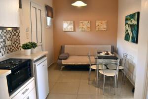 Area soggiorno di Roula Kotsonis Superior Apartment