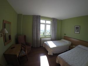 A bed or beds in a room at Dunas de Oyambre