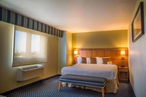 A bed or beds in a room at Courtyard Aguadilla