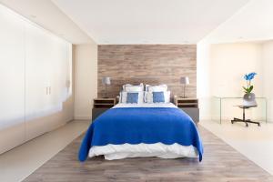 Un ou plusieurs lits dans un hébergement de l'établissement Rooms & Suites Loft 2H Deluxe Edition Arrecife