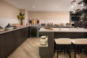 A kitchen or kitchenette at Vancouver Airport Marriott Hotel