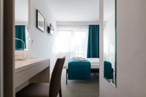 A bed or beds in a room at Hotel Porec