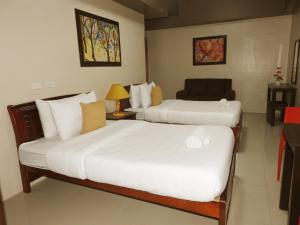 A bed or beds in a room at Residenciale Boutique Apartments