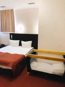 Кровать или кровати в номере Отель Елоховский Сити