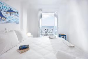 A bed or beds in a room at Karma Minoan