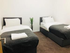 A bed or beds in a room at Showcase Apartments - Highcross House