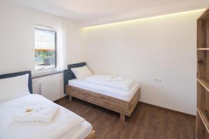 Ein Bett oder Betten in einem Zimmer der Unterkunft Thermalhotel Aulendorf
