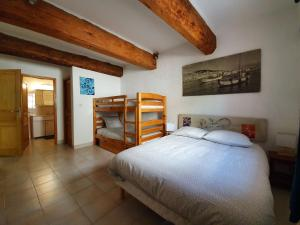 A bunk bed or bunk beds in a room at il porto