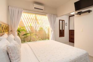 A bed or beds in a room at Pousada Riacho dos Milagres