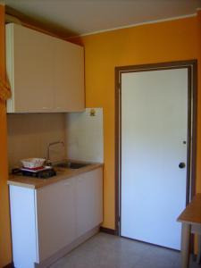 Kuchyň nebo kuchyňský kout v ubytování Residenza Grecale