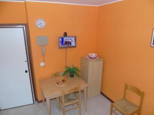 TV a/nebo společenská místnost v ubytování Residenza Grecale