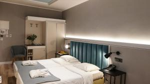 A bed or beds in a room at Athens Cypria Hotel