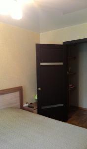 Кровать или кровати в номере Квартира на Кирова 8