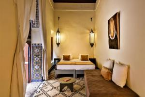 Un ou plusieurs lits dans un hébergement de l'établissement Hotel & Spa Dar Bensouda