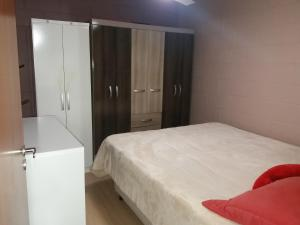 A bed or beds in a room at Apartamento Temporada Canela