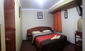 A bed or beds in a room at Hostel Cesars