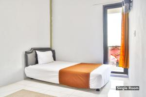 A bed or beds in a room at Barkah Place