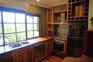 A kitchen or kitchenette at Bridgefield Guest House