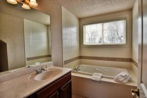 A bathroom at Unit 303 Two-Bedroom Condo