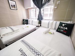 A bed or beds in a room at Comfort Guest House
