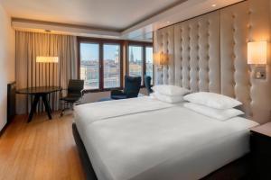 A bed or beds in a room at Hilton Stockholm Slussen Hotel